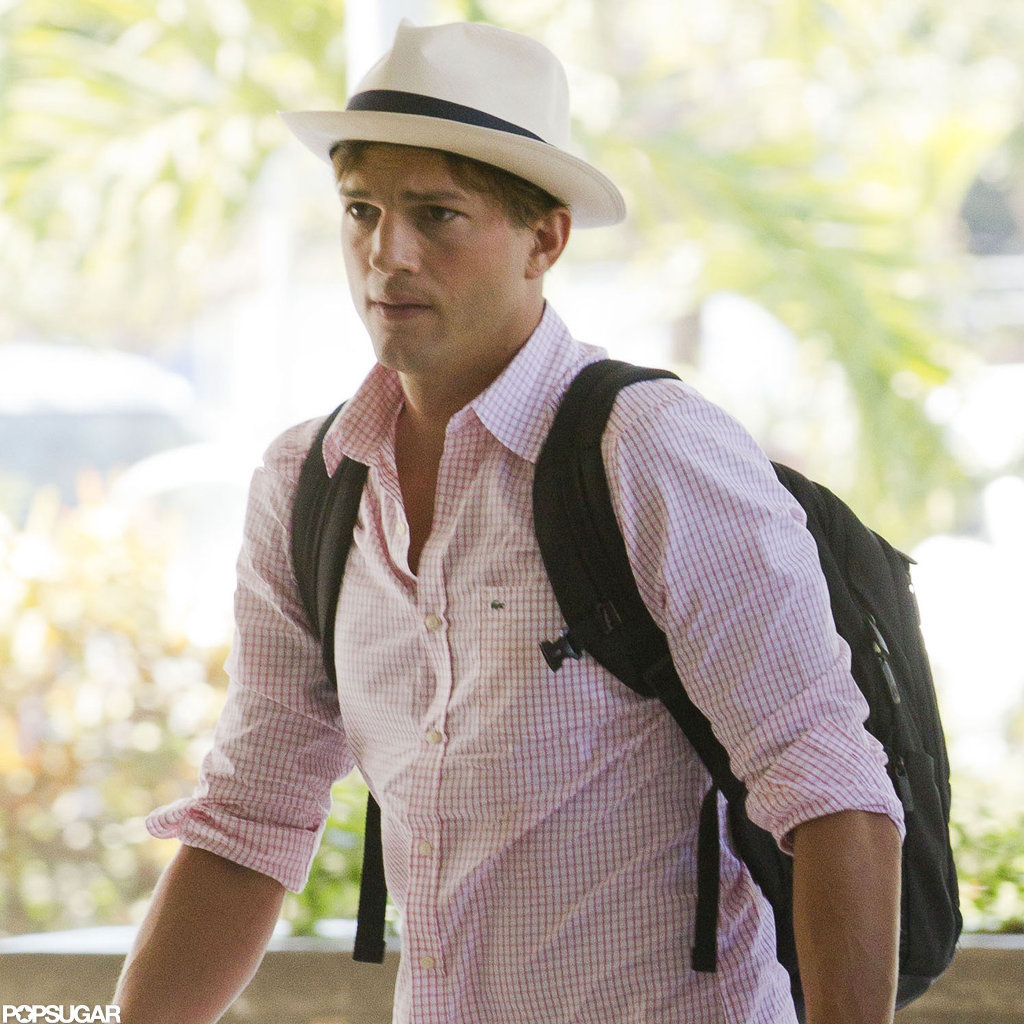 Ashton Kutcher carried a backpack through the airport.