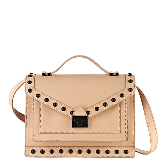 The hammered hardware on this bag gives it a little something extra — the leather studs are equal parts girlie and tough, and the discreet straps can even fasten to a bicycle. Loeffler Randall Rider Bag ($595)