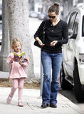 Jennifer Garner walked in LA with daughter Violet Affleck, who was buried in a copy of Sleepover Sleuths (Nancy Drew and the Clue Crew), in October 2010.