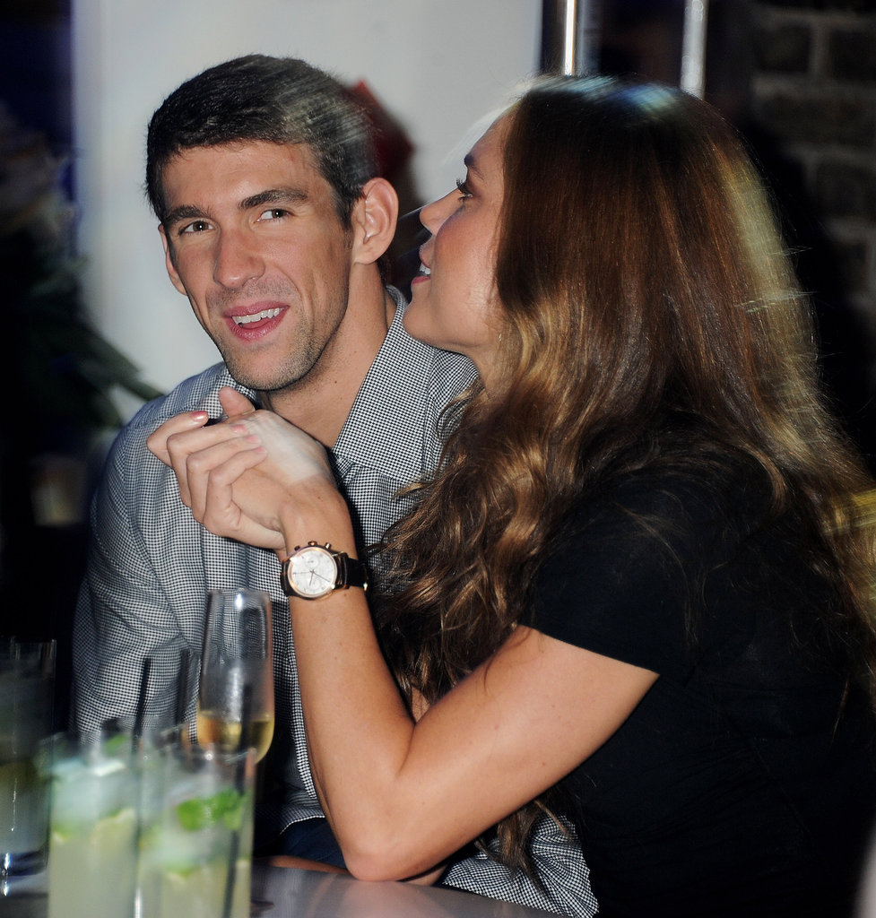 Michael Phelps hung out with Natalie Coughlin at a party in London.