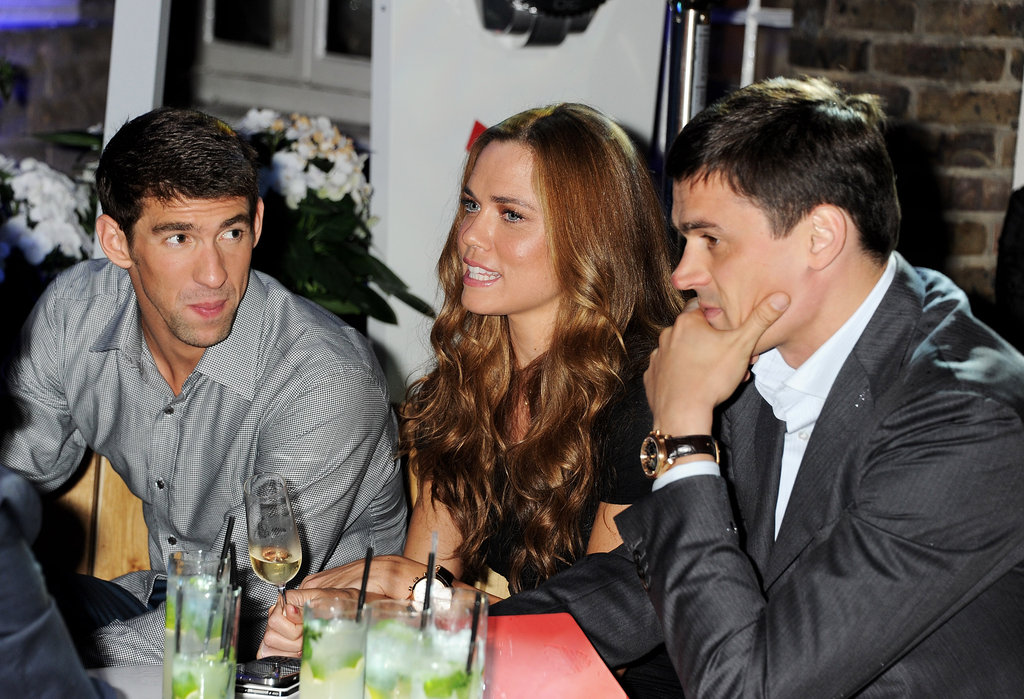 Michael Phelps relaxed with Natalie Coughlin and Alexander Popov at a party in London.
