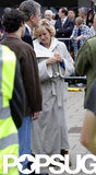 Naomi Watts wore a robe on set.