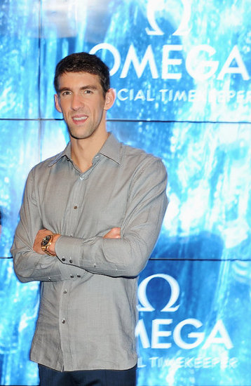 Michael Phelps had his arms crossed to pose at a swimming party in London.