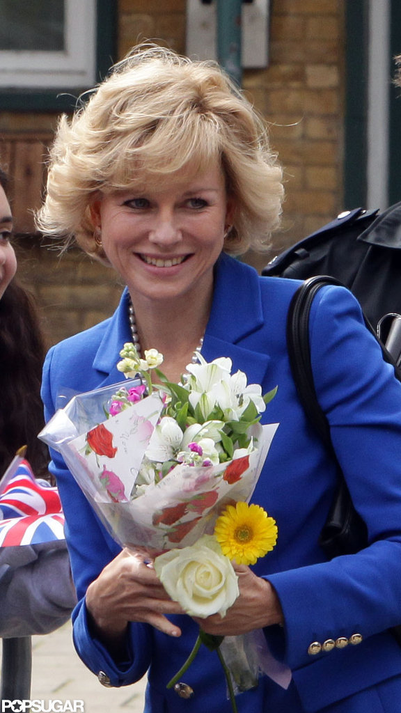 Naomi Watts held flowers on set filming as Princess Diana.