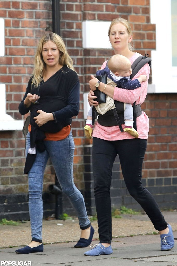 Sienna Miller walked with her sister Savannah and their babies.