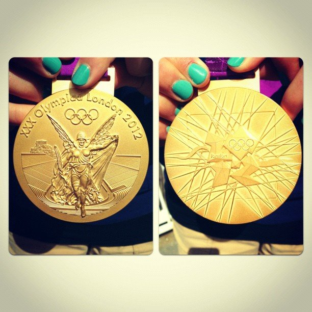 Shawn Johnson got up close and personal with a gold medal. Source: Instagram user shawnjohnson