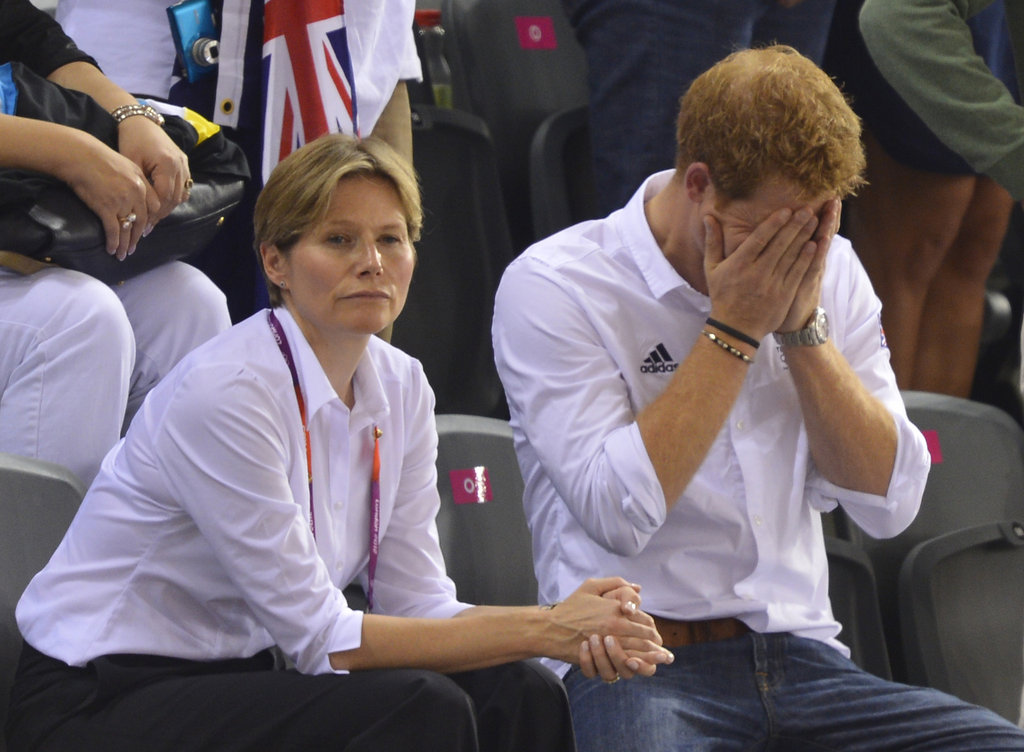 Prince Harry hid his face.