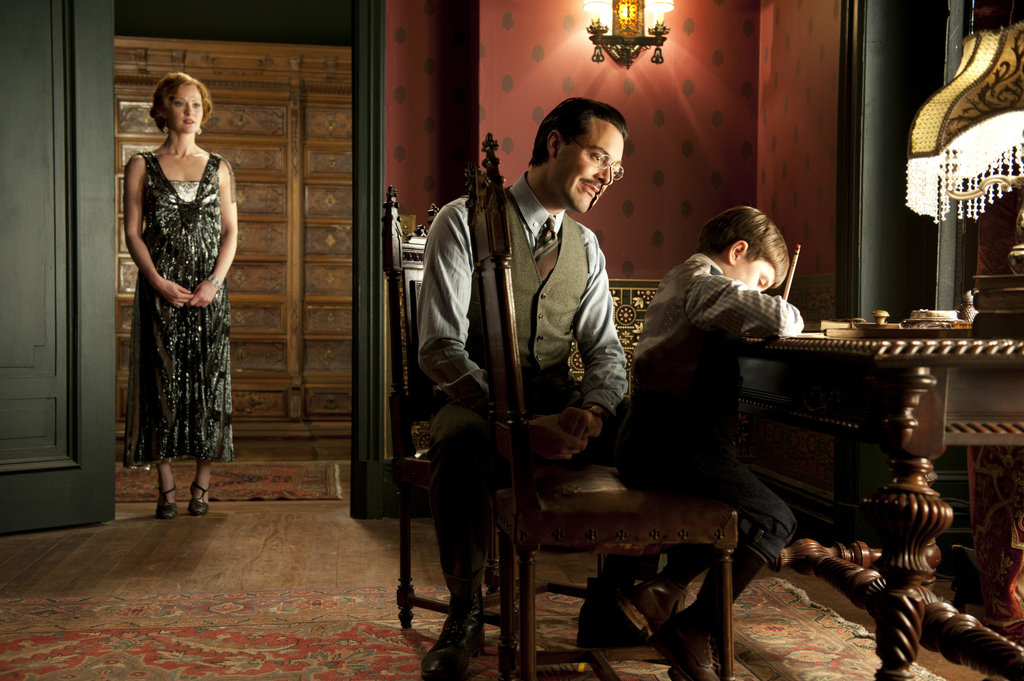 Gretchen Mol, as Gillian Darmody, watches on as Richard Harrow (Jack Huston) bonds with Tommy (Brady Noon).