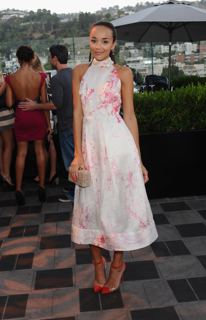 Ashley Madekwe chose a halter-style Zimmerman Resort 2013 dress that evoked a distinctly Summer-perfect feel, thanks to its dainty pink splatter details. To finish the look, she added an Edie Parker clutch and red Christian Louboutin Bis Un Bout pumps.