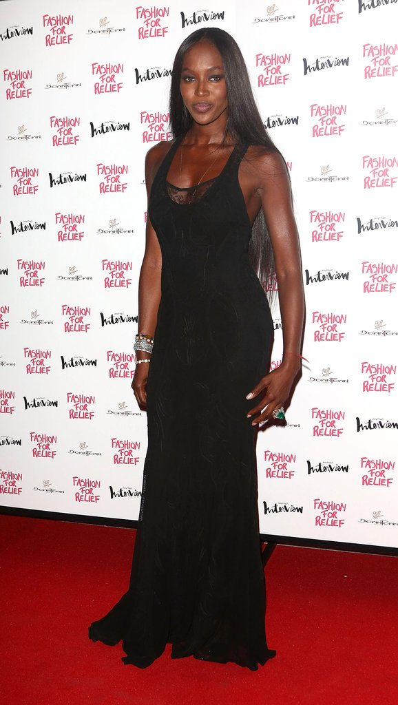 Naomi Campbell wore a black floor-length dress to host a Fashion for Relief charity dinner in London.