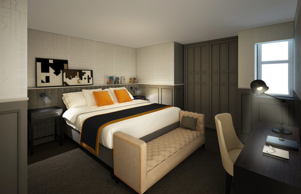 The deluxe suite features seating areas and a private bedroom and desk area.