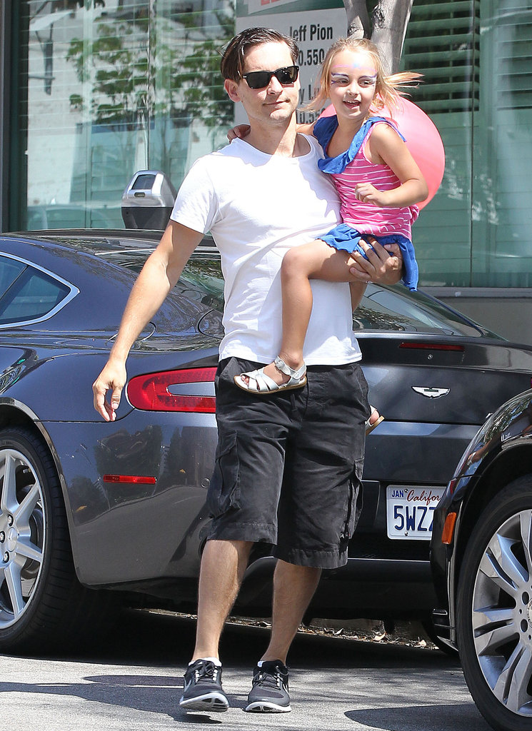Tobey Maguire carried his daughter, Ruby, to a birthday party in LA.