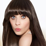 "Zooey Deschanel is admittedly ""really into hair."""
