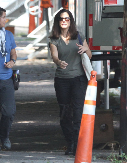 Sandra Bullock walked onto set while chatting with a production assistant.