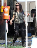 Sandra Bullock carried a bag on one shoulder.