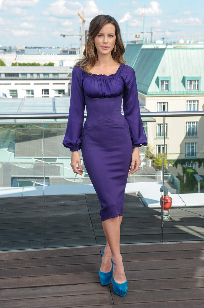 Kate was extremely ladylike in a purple, ruched-sleeve dress by Zac Posen at the Berlin photocall. Her blue Christian Louboutin pumps gave an extra boost of color.