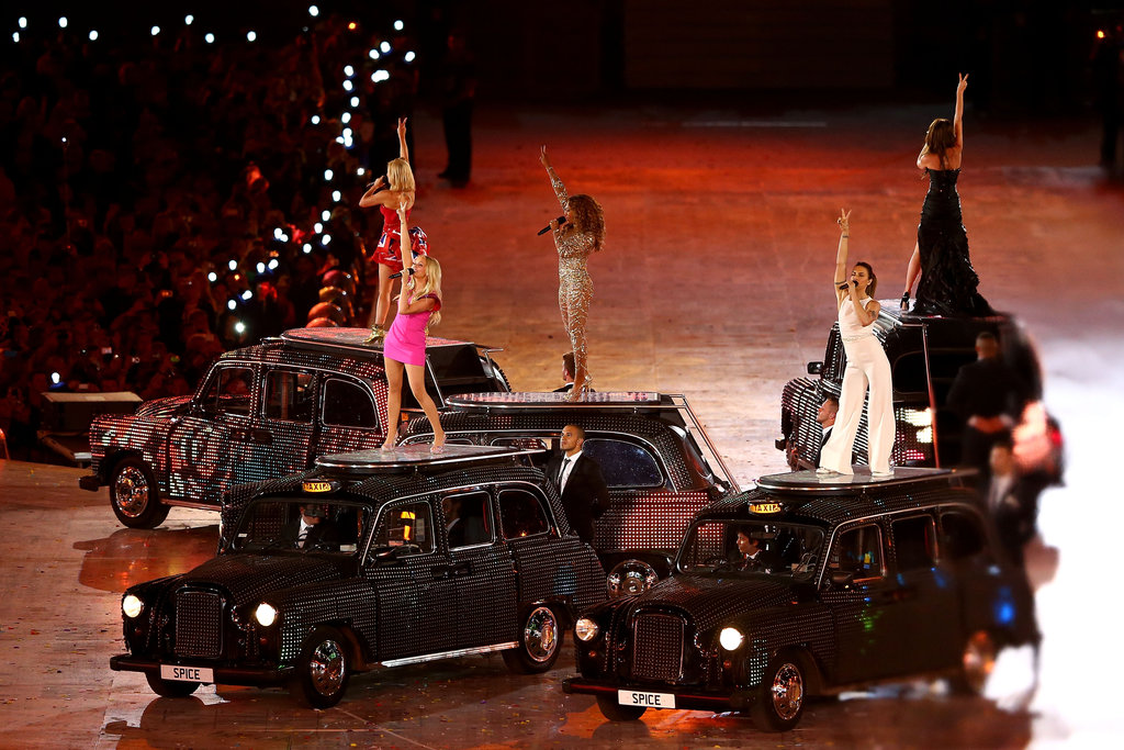 Sky-high heels and formfitting ensembles were no obstacle in striking a pose atop London's signature black taxis.