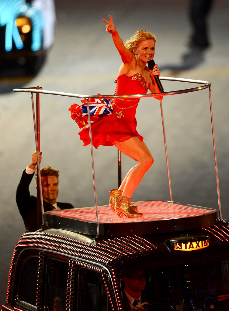 Geri Halliwell, aka Ginger Spice, showed off her patriotism with a red strapless Union Jack-infused dress by Suzanne Neville. She also wore gold glitter Isabel Marant booties.