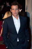 Clive Owen tucked his hands in his pockets.