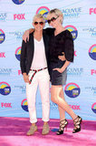 Ellen DeGeneres and Portia de Rossi struck a pose at the July 2012 Teen Choice Awards in LA.