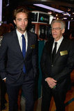 Robert Pattinson and his director David Cronenberg posed together at the New York Stock Exchange.