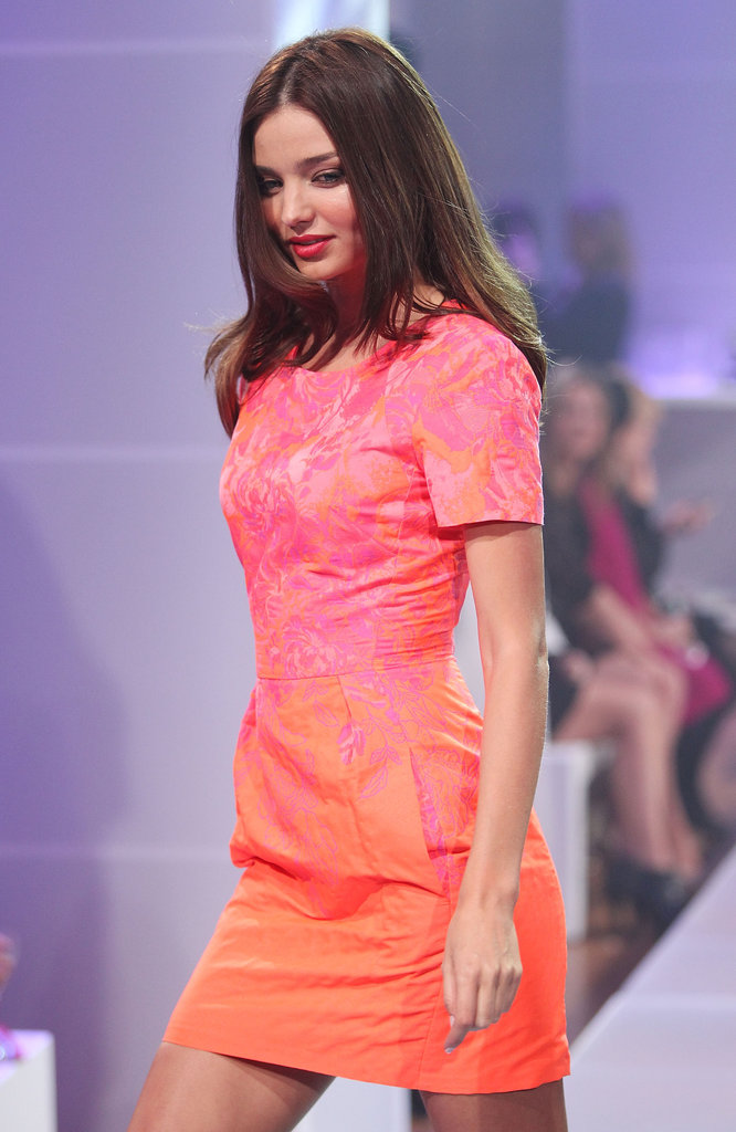 Miranda Kerr modeled a brightly colored knee-length dress.