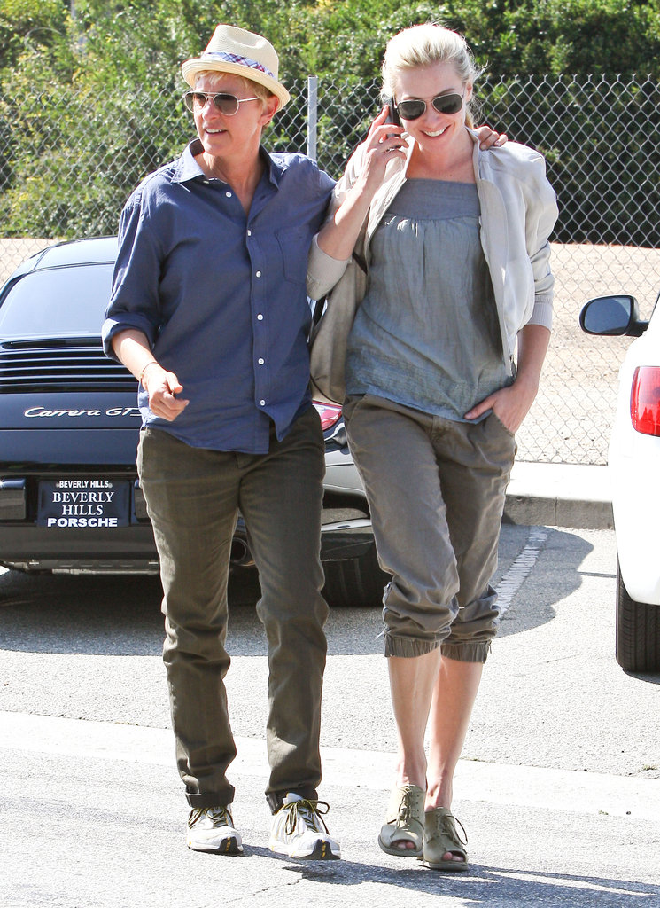 Ellen DeGeneres put her arm around Portia de Rossi while walking and talking in LA in September 2011.