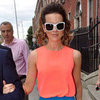 Kate Beckinsale Wearing Blue Skirt and Orange Top