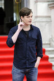Sam Riley looked neat and casual in a button down and jeans.