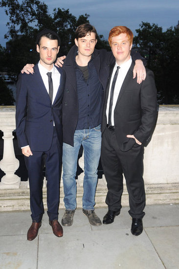 Tom Sturridge, Sam Riley, Danny Morgan smiled together.
