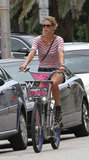 Doutzen Kroes cruised around Miami in the perfect blend of red stripes, denim cutoffs, and edgy black Givenchy sandals.