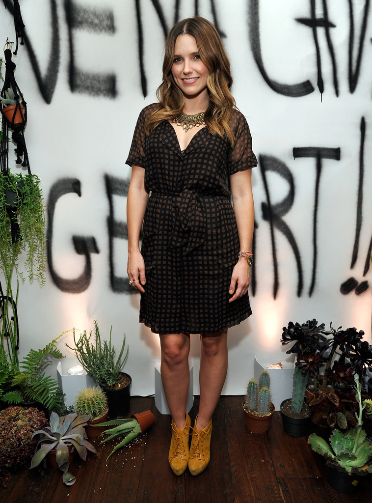 Sophia Bush mixed cool saffron-hued booties with a brown-and-black-checked cocktail-perfect sheath on top — we love it.