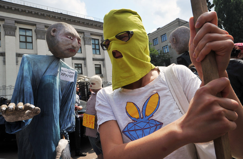 Demonstrators wore masks similar to those the women wore.