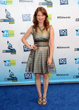 The Office's Ellie Kemper wore a metallic printed fit-and-flare dress with strappy black heels and a bold red lip.