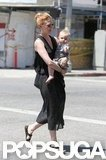 January Jones wore black sandals as she carried Xander.