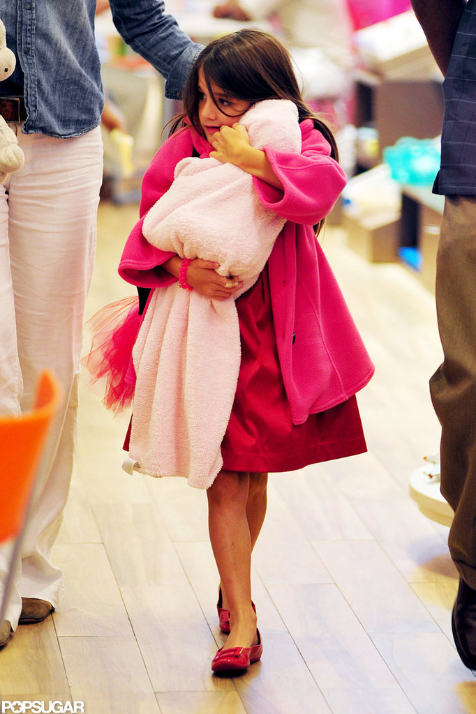 Suri Cruise cuddled with her baby-doll while shopping with Katie Holmes.
