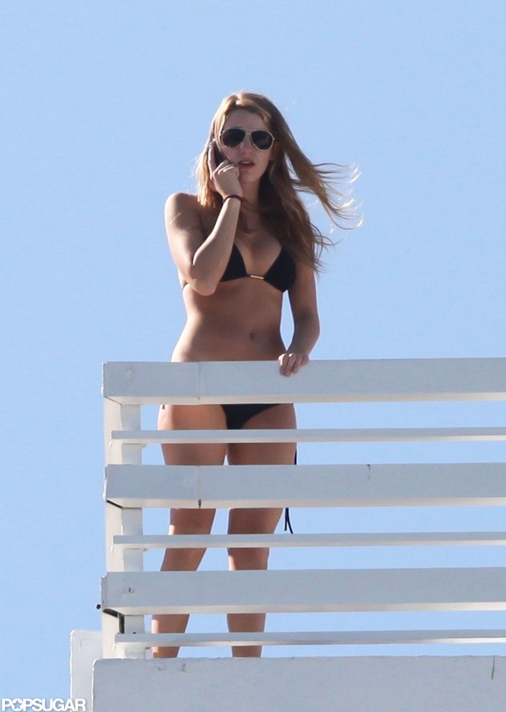 Blake Lively chatted in her bikini while visiting Miami in February 2010.