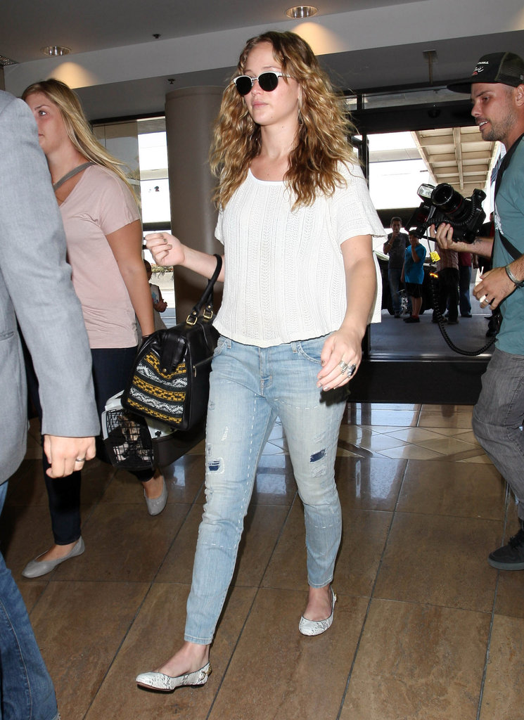 Jennifer Lawrence looked cool and casual walking through LAX.