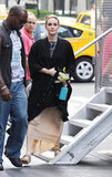 Leighton Meester covered her costume with a black robe on the set of Gossip Girl in NYC.
