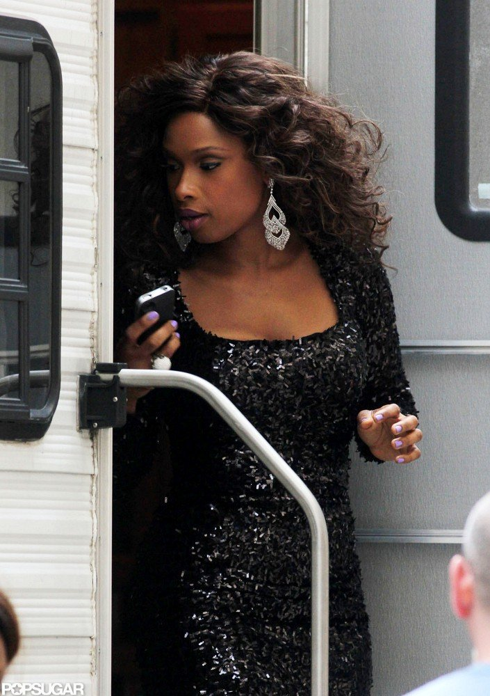 Jennifer Hudson walked out of her trailer wearing big earrings.