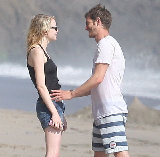 Andrew Garfield and Emma Stone had a romantic embrace on the beach.