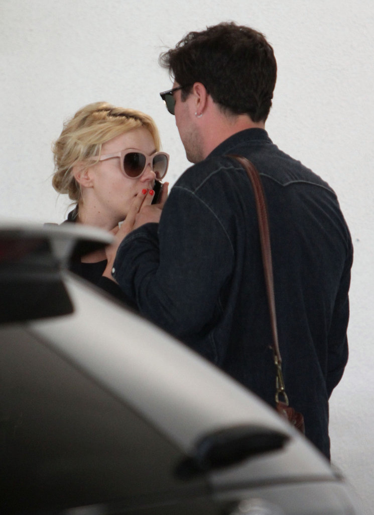 Carey Mulligan talked on the phone near husband Marcus Mumford.
