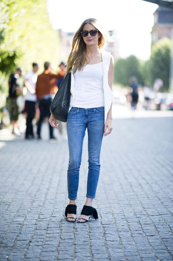 We love how this styler countered classic skinny jeans with a pair of fringed sandals and a chic open vest for something a little more eye-catching. Source: Adam Katz Sinding