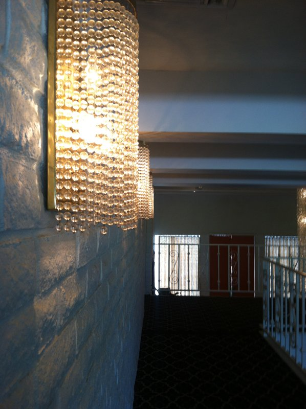 A shot of the beaded hallway sconces.