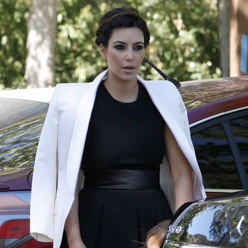 Kim Kardashian Wearing Black Dress and White Blazer