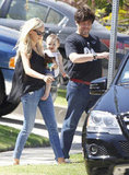 Kimberly Stewart and Delilah Join Benicio Del Toro For Family Time