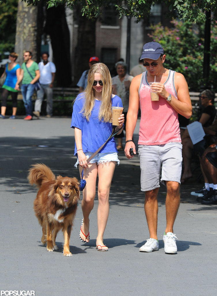 Amanda Seyfried and a friend gave Amanda's dog some attention in NYC.
