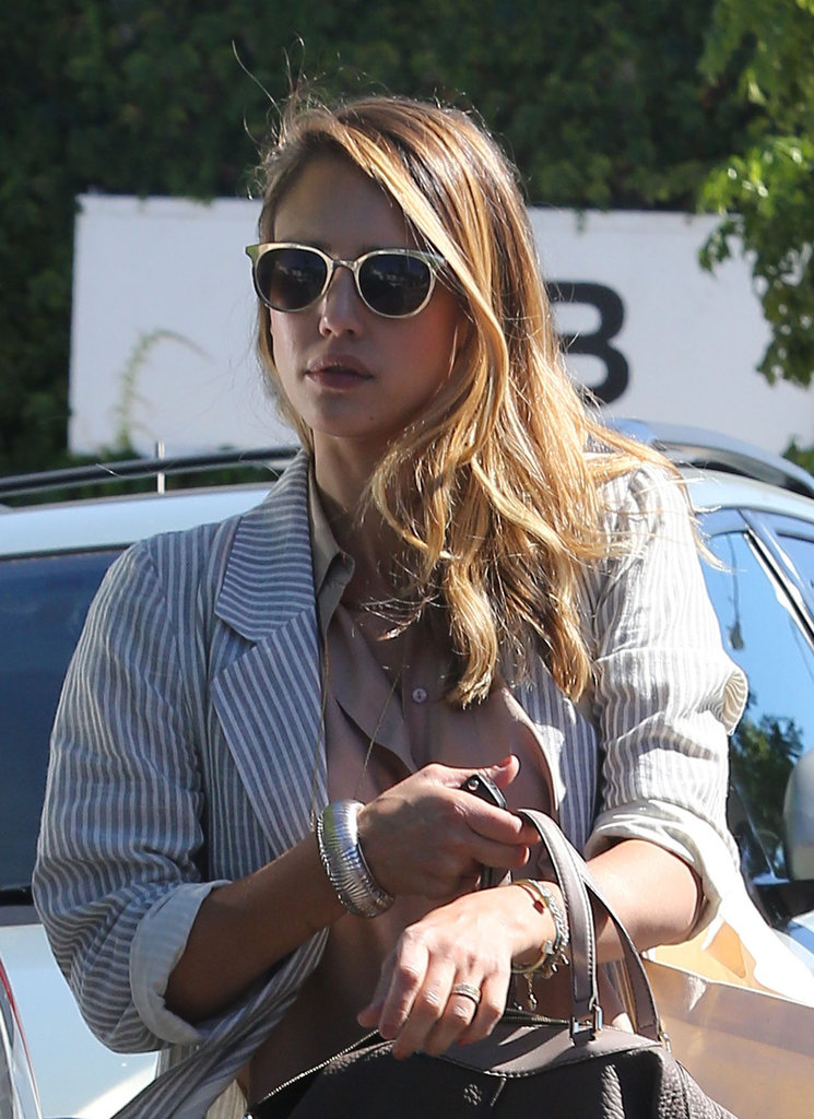 Jessica Alba wore her hair over one shoulder.