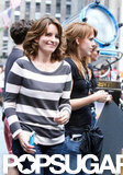 Tina Fey flashed a smile between takes.