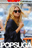 Ashley Olsen wore sunglasses and a black shirt out in NYC.